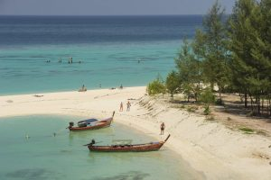 Tourist visit beautiful beach and crystal sea at Koh Lipe island in Satun, Thailand
