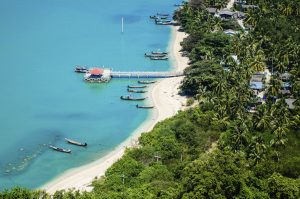 The Old marina or the pier or the port on the beach of fisherman living. Top view on the mountain Traditional fishing village is secluded and clear turquoise sea waters. On Nokpao Island (Kohnokpao), Surath Thani, Thailand.