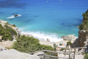 Blue beach with some people seen from the top. Cala Goloritze (Sardinia) in summertime