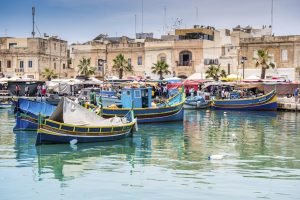MARSAXLOKK HARBOR, MALTA - MAY 24: Fishing boats in Marsaxlokk harbor. Malta on May 24, 2015.