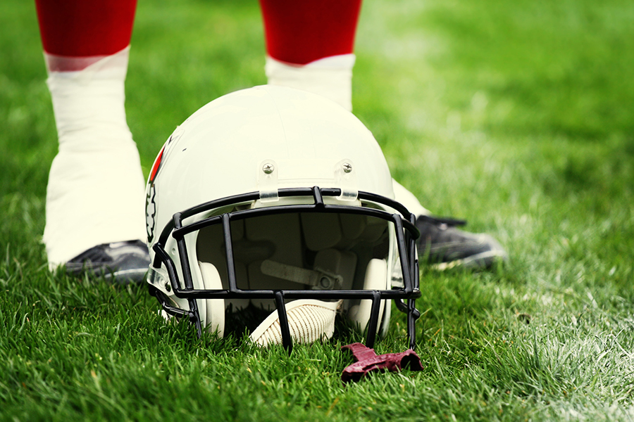 American football equipment - helmet. Sport concept. Football player boots